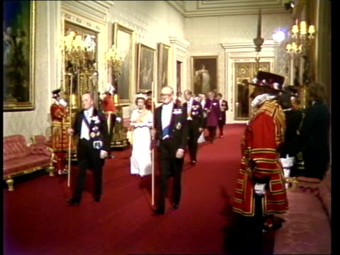 nepal state visit london buckingham palace ms royal party along corridor in buckingham palace going into banquet eng sony itn 21secs tx archive tape... - state visit stock videos & royalty-free footage
