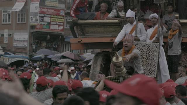 Nepalese man cheers on Bunga Dyah Jatra chariot