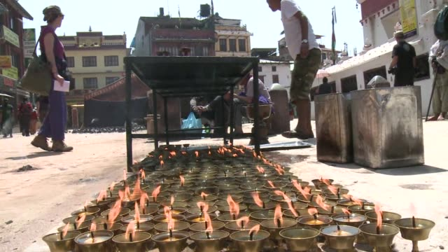 nepalese offer prayers at boudhanath stupa in kathmandu a week after the 78 magnitude earthquake hit the himalayan region - stupa stock videos & royalty-free footage