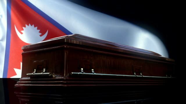nepali flag behind coffin - nepali flag stock videos & royalty-free footage