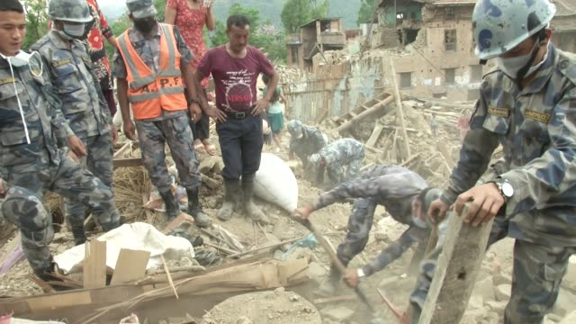 Nepali Military Police help dig out a destroyed home to recover residents belongings in Khokana / A major earthquake hit Kathmandu midday on Saturday...