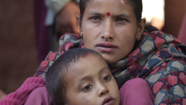 nepali mother and son - earring stock videos & royalty-free footage