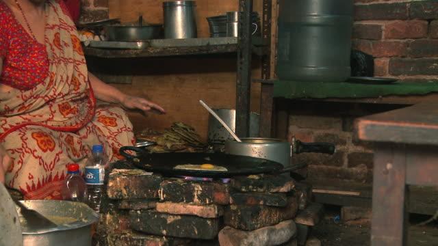 Nepali woman cooking Nepali food.