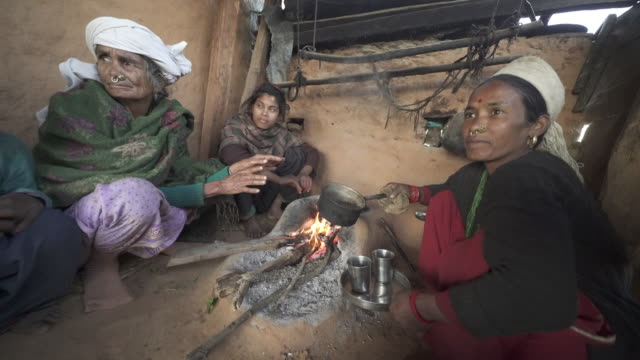 nepali woman pours hot beverage by fire - nose piercing stock videos & royalty-free footage