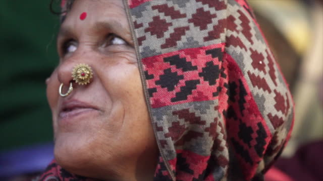 nepali woman with nose piercings smiles at camera - nose piercing stock videos & royalty-free footage