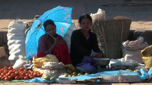 nepali women selling fruit at a market in nepal. - nepal stock-videos und b-roll-filmmaterial