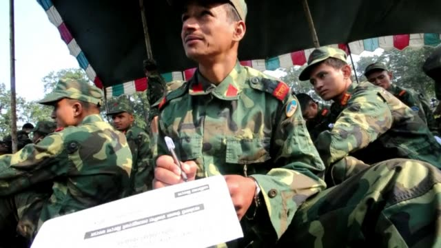 nepal's maoist fighters begin the process of leaving cantonment camps they have called home since the end of their insurgency in 2006 to join the... - maoism stock videos & royalty-free footage