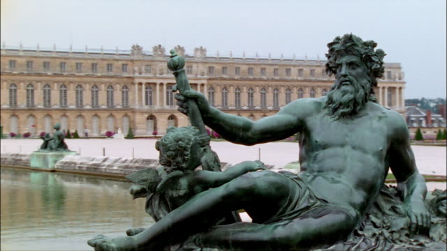 ms, pan, neptune statue at garden of versailles, france - 17th century stock videos & royalty-free footage