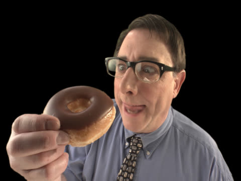 nerd eating donut - this clip has an embedded alpha-channel - keyable stock videos and b-roll footage