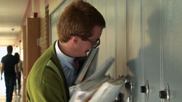 nerd trying to open locker - see other clips from this shoot 1148 stock videos and b-roll footage