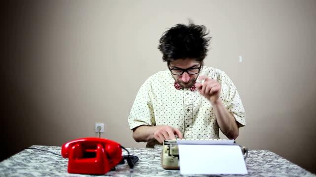 nerd writer typing on a typewriter - geek stock videos & royalty-free footage
