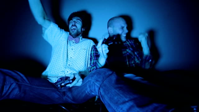 nerdy boys screams while playing with joystick - geek stock videos & royalty-free footage