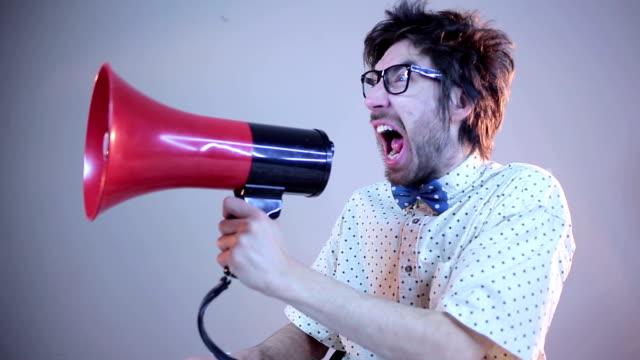 Nerdy guy screaming on megaphone