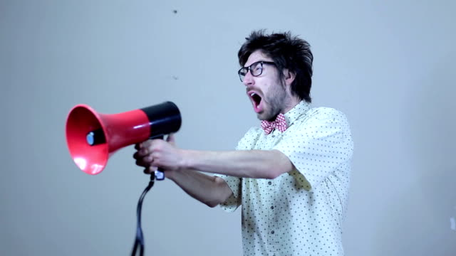 nerdy guy screaming on megaphone - obscene gesture stock videos and b-roll footage