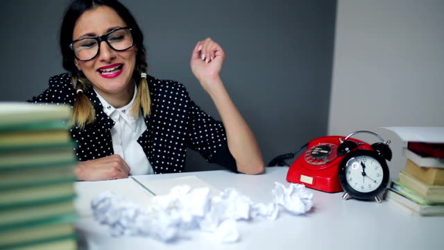 nerdy secretary having bad day on work - crumpled paper stock videos and b-roll footage