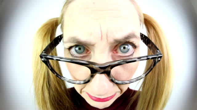 nerdy stern face looking over glasses - wide angle stock videos & royalty-free footage