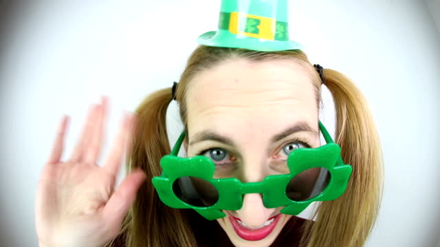 nerdy woman dressed for st. patrick's day - st. patrick's day stock videos & royalty-free footage