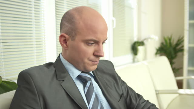 HD: Nervous Businessman In Waiting Room