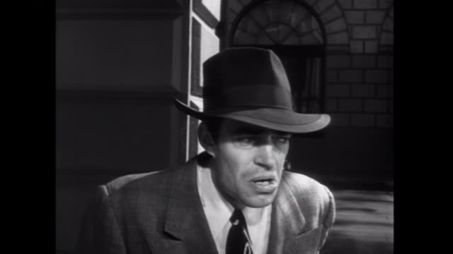 1952 a nervous gangster lights a cigarette in a phone booth - telefonzelle stock-videos und b-roll-filmmaterial