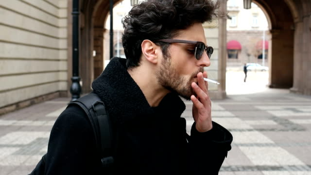 nervous man smoking on the street - smoking issues stock videos & royalty-free footage