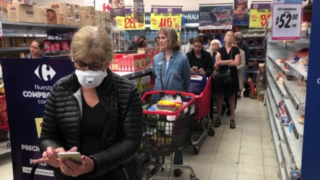 nervous members of argentina's middle class rush to supermarkets to buy products over fear of a possible quarantine due to the novel coronavirus as... - middle class stock videos & royalty-free footage