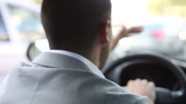nervous young businessman in a car honking the horn in traffic - aggression stock videos & royalty-free footage