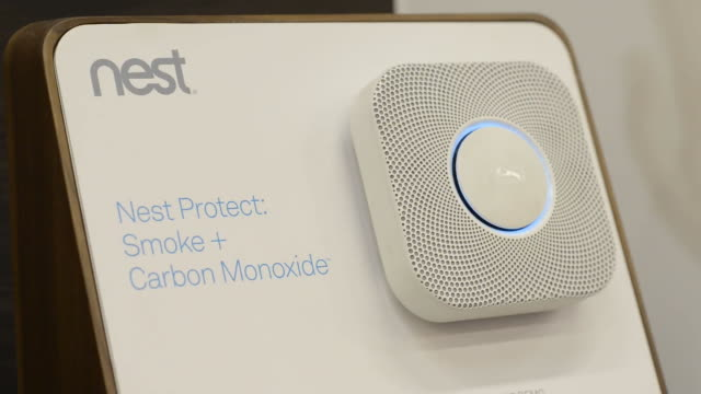 a nest labs inc digital thermostat and smoke and carbon monoxide alarm is displayed at a home depot inc store in emeryville california us on tuesday... - carbon monoxide stock videos & royalty-free footage