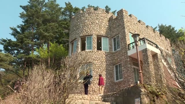 nestled on a cliff just a few kilometres from the eastern end of the demilitarized zone that divides the korean peninsula stands a small stone villa - peninsula stock videos & royalty-free footage
