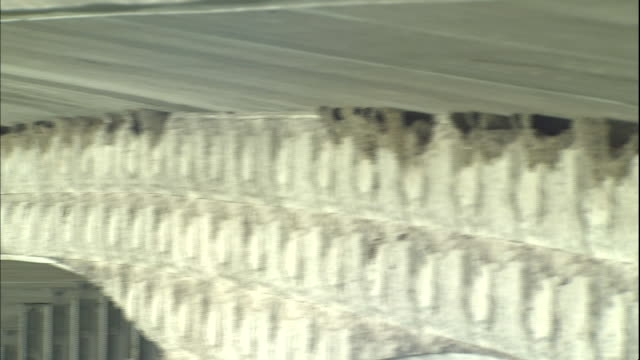vidéos et rushes de nests of house martins line up under the niijima bridge in japan. - se percher