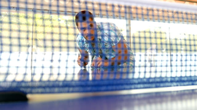 net shot of a young adult man serving the ball - table tennis stock videos & royalty-free footage