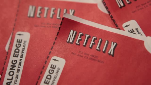 Netflix Inc DVD mailers are arranged for a photograph in Washington DC US Netflix DVD Envelopes on January 20 2014 in Washington DC District of...
