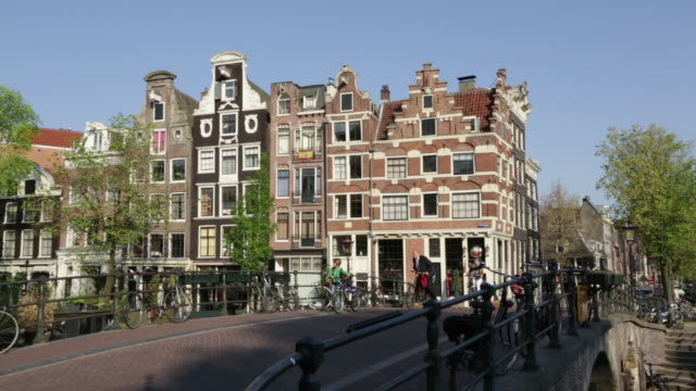 Netherlands, Amsterdam, Canal called Prinsengracht, Cyclists, UNESCO World heritage Site
