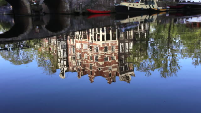 Netherlands, Amsterdam, Reflections of canal houses in canal called Brouwersgracht. UNESCO World Heritage Site