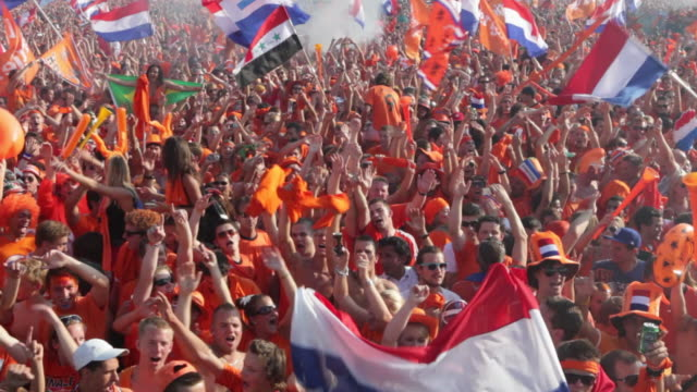 netherlands, amsterdam, supporters of dutch national football team during the world championship 2010, watching the final against spain on square called museumplein. many people dressed in orange, the national color. - fifa stock videos & royalty-free footage