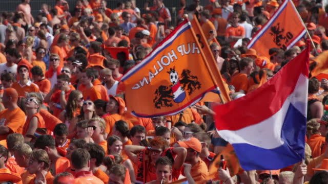 netherlands, amsterdam, supporters of dutch national football team during the world championship 2010, watching the final against spain on square called museumplein. many people dressed in orange, the national color. - netherlands stock videos & royalty-free footage