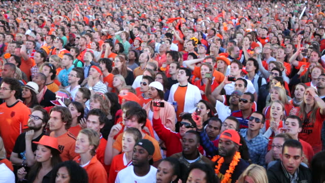 netherlands, amsterdam, supporters of dutch national football team during the world championship 2010, watching the final against spain on square called museumplein. many people dressed in orange, the national color - fifa stock videos & royalty-free footage