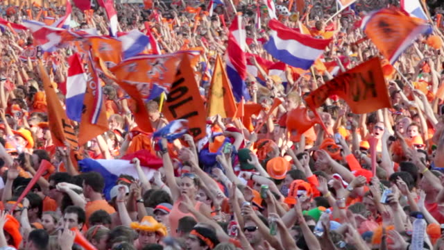 netherlands, amsterdam, supporters of dutch national football team during the world championship 2010, watching the final against spain on square called museumplein. many people dressed in orange, the national color - netherlands stock videos & royalty-free footage