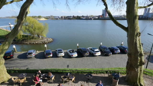 netherlands cafe by the lek river - lek stock videos & royalty-free footage