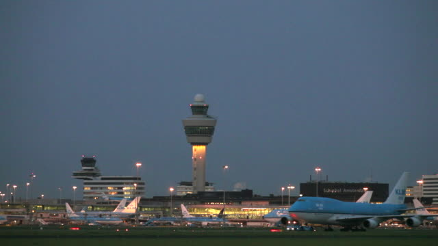 Netherlands, Haarlemmermeer, Amsterdam International Airport Schiphol. KLM airplanes. Dawn, twilight