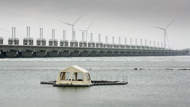 Netherlands, Kamperland, near Veere, Oosterschelde Flood Barrier. Part of the Delta Works. Foreground fish research