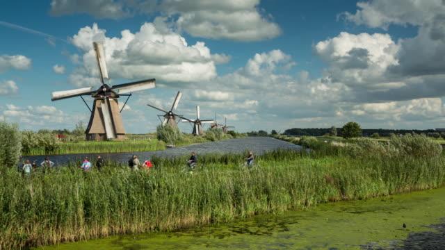 netherlands, kinderdijk, windmills turning in alblasserwaard polder, unesco world heritage site - rotterdam stock videos and b-roll footage