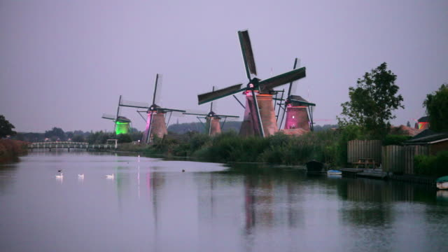 Netherlands, Kinderdijk, Windmills, UNESCO World Heritage Site. Twilight, dusk. Windmills specially lit with coloured led-spots