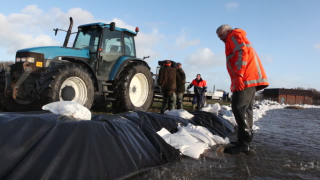 netherlands, lauwersoog, protecting land with sandbags against flooding - sandbag stock videos and b-roll footage