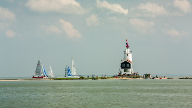 netherlands, marken, view on lighthouse and yachts - olanda settentrionale video stock e b–roll