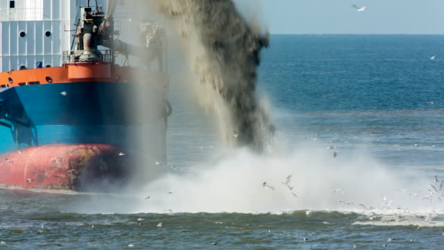 Netherlands, Petten, Reinforcement of sea dike called Hondsbossche Zeewering. A Trailing Suction Hopper Dredger is depositing sand in front of the dyke