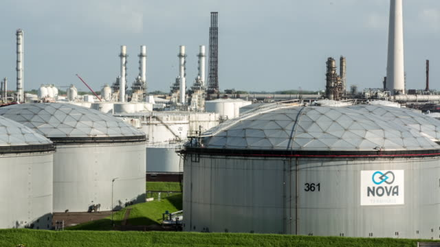 netherlands, rotterdam, port of rotterdam. oil storage in harbour - ölindustrie stock-videos und b-roll-filmmaterial