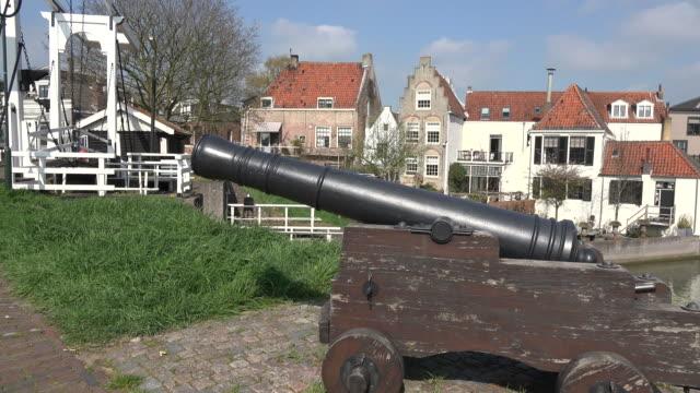 netherlands schoonhoven cannon by drawbridge - drawbridge stock videos and b-roll footage