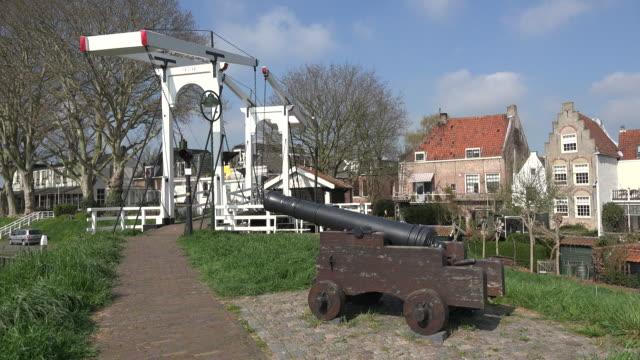 netherlands schoonhoven cannon points toward drawbridge - drawbridge stock videos and b-roll footage