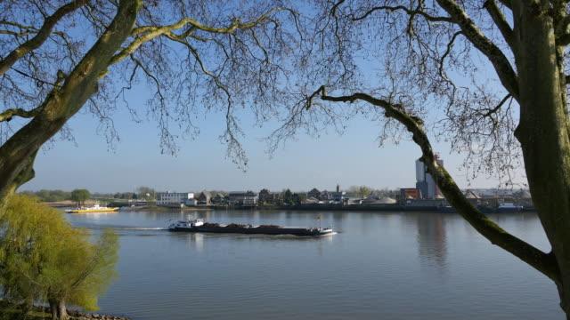 netherlands schoonhoven coal barge on lek river - lek stock videos & royalty-free footage