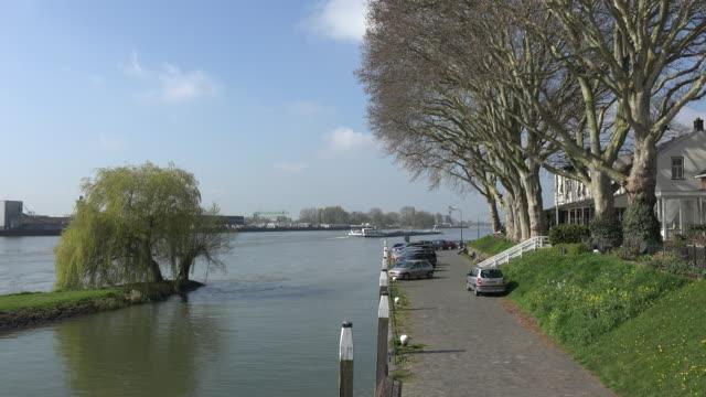 netherlands schoonhoven river by hotel - lek stock videos & royalty-free footage